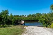 Private Boat Ramp For Oyster Creek MHP Residents Only - Single Family Home for sale at 21 Turtle Bay Cir, Englewood, FL 34224 - MLS Number is D6114730