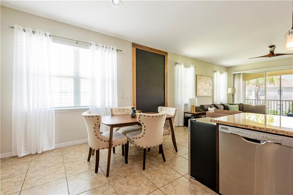 Chalk Wall Separating the Dining from Living Room - Condo for sale at 3129 Oriole Dr #101, Sarasota, FL 34243 - MLS Number is T3253701