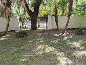 left side yard - Single Family Home for sale at 1701 Hashay Dr, Sarasota, FL 34239 - MLS Number is U8097547
