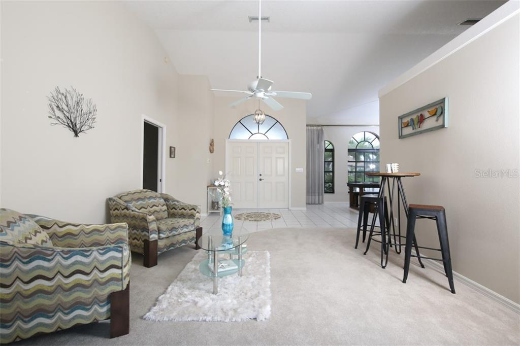 Spacious dining room with lovely windows to bring in light - Single Family Home for sale at 3419 Sandpiper Dr, Punta Gorda, FL 33950 - MLS Number is C7232529