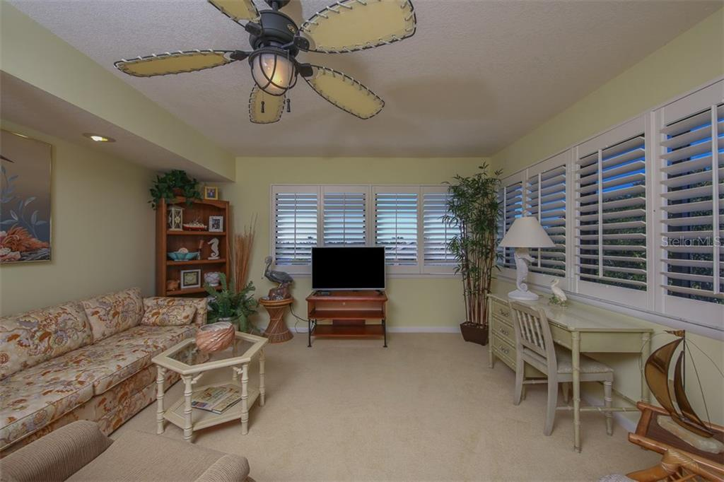 Family room with plantation shutters - Condo for sale at 1765 Jamaica Way #302, Punta Gorda, FL 33950 - MLS Number is C7234643