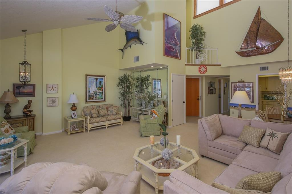 Soaring vaulted ceilings with wonderful entertaining spaces - Condo for sale at 1765 Jamaica Way #302, Punta Gorda, FL 33950 - MLS Number is C7234643