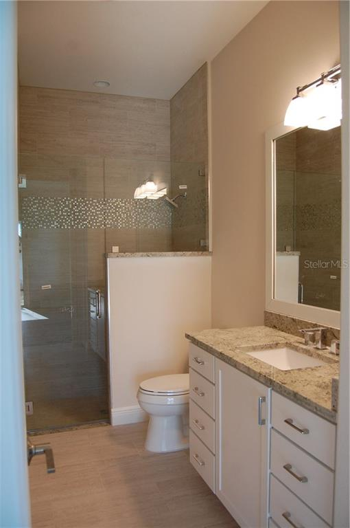 GUEST BATHROOM WITH SHOWER - Single Family Home for sale at 6030 Hollywood Blvd, Sarasota, FL 34231 - MLS Number is C7235083