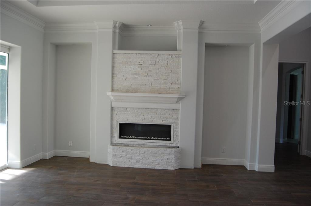 ELECTRIC FIRE PLACE - Single Family Home for sale at 6030 Hollywood Blvd, Sarasota, FL 34231 - MLS Number is C7235083