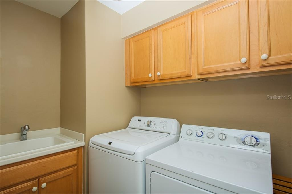 Laundry room with sink and generous storage. - Condo for sale at 3313 Sunset Key Cir #402, Punta Gorda, FL 33955 - MLS Number is C7236886
