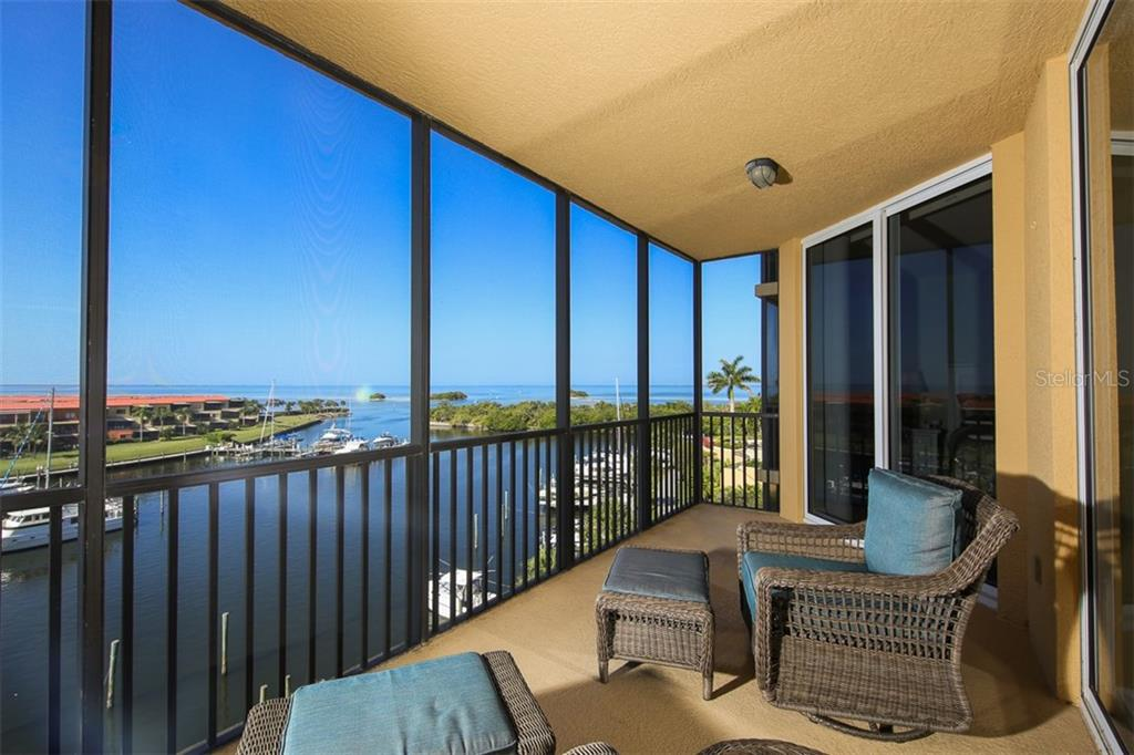 Curl up and partake in the endless parade of power and sailing vessels that enter and depart Burnt Store Marina.  Whether leaving or returning, this most certainly is the place for phenomenal boating and fishing! - Condo for sale at 3313 Sunset Key Cir #402, Punta Gorda, FL 33955 - MLS Number is C7236886