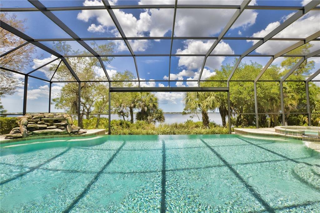 Your fabulous view from your Great Room is breathtaking and very inviting! - Single Family Home for sale at 2839 Mill Creek Rd, Port Charlotte, FL 33953 - MLS Number is C7238545