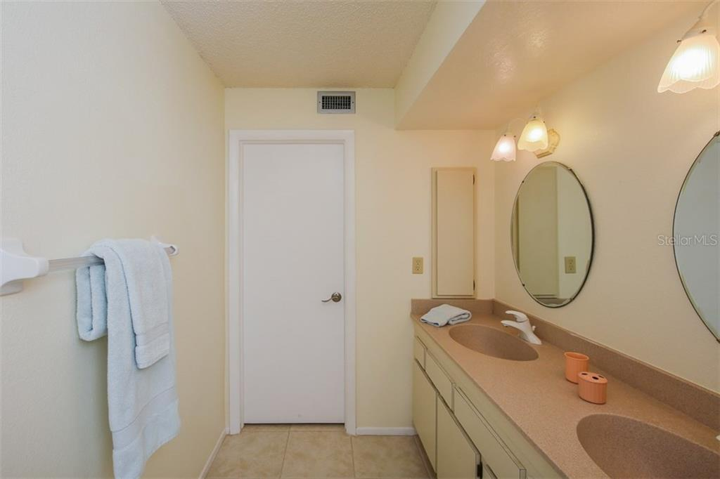 Dual vanity sink in master bathroom with walk-in shower - Condo for sale at 5050 Marianne Key Rd #4b, Punta Gorda, FL 33955 - MLS Number is C7239311