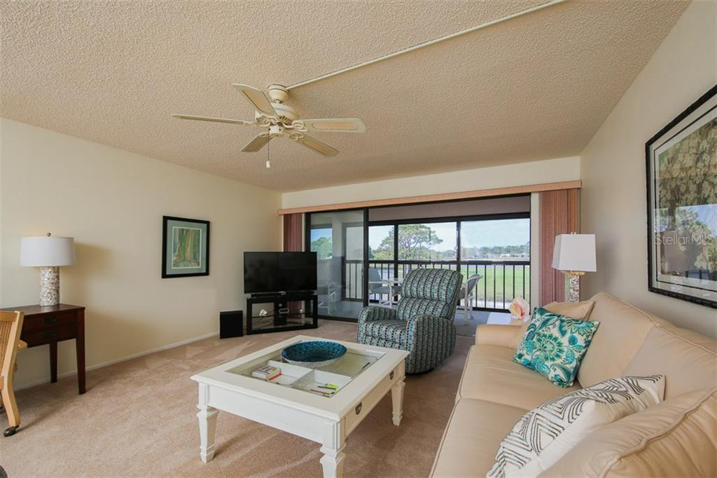 Spacious living room with sliders to the beautiful outdoors - Condo for sale at 5050 Marianne Key Rd #4b, Punta Gorda, FL 33955 - MLS Number is C7239311
