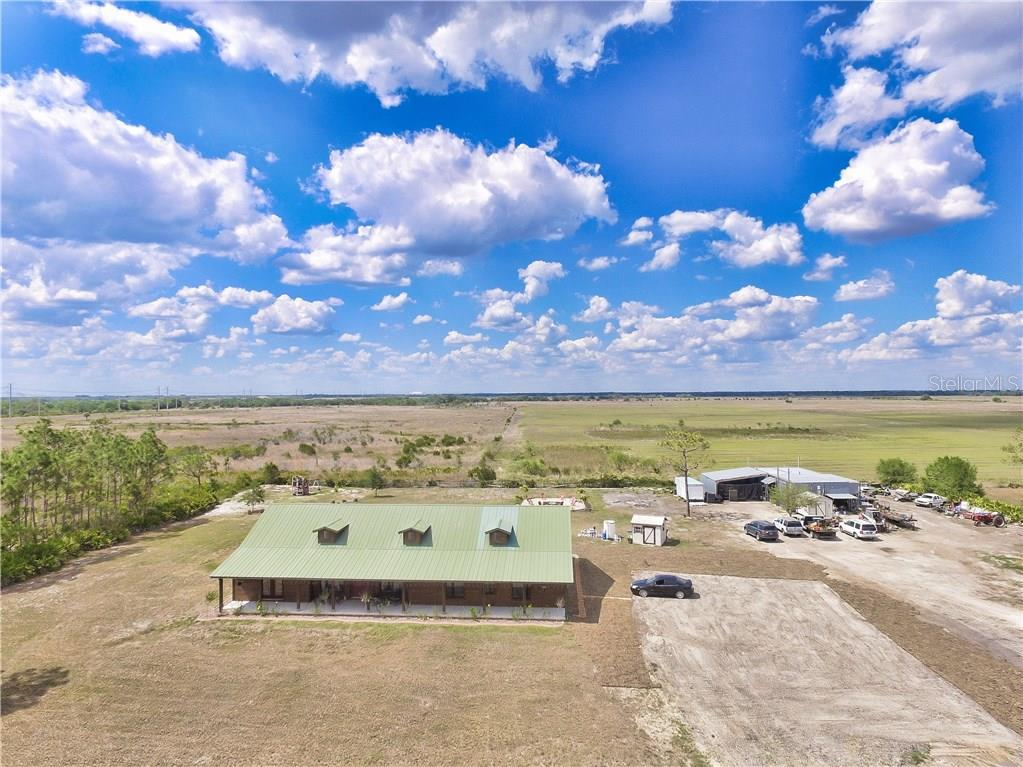 This homeowner does run a business from the workshop. Acreage behind home is all pasture and not part of this sale. - Single Family Home for sale at 30720 Washington Loop Rd, Punta Gorda, FL 33982 - MLS Number is C7239690