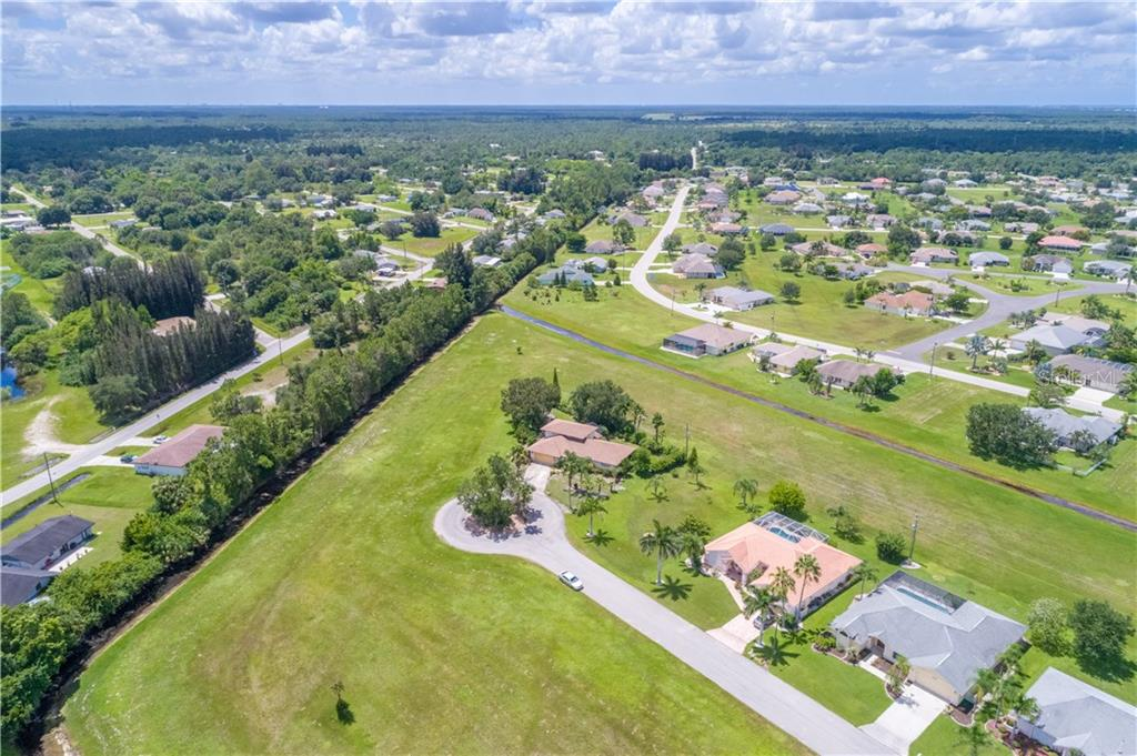You can see the massive greenbelt areas behind the home - ensuring privacy. - Single Family Home for sale at 7353 S Plum Tree, Punta Gorda, FL 33955 - MLS Number is C7242349