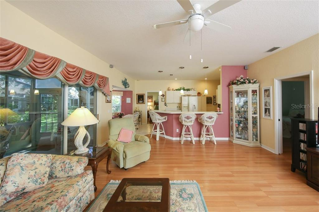 Great room opens to the kitchen - perfect for entertaining - Villa for sale at 1234 Green Oak Trl, Port Charlotte, FL 33948 - MLS Number is C7243720