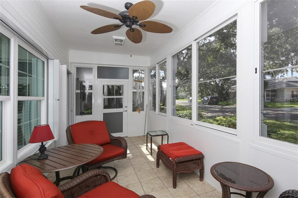 Lovely enclosed lanai with tile flooring - Villa for sale at 1268 Green Oak Trl, Port Charlotte, FL 33948 - MLS Number is C7243755