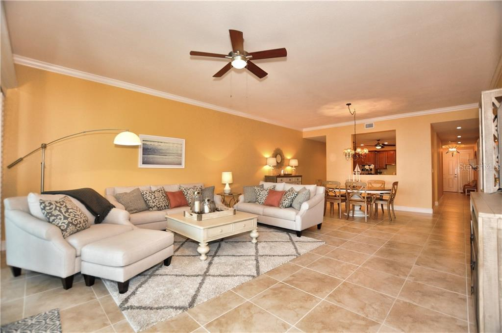 Great Room and Dining Room looking into kitcen and foyer - Condo for sale at 95 N Marion Ct #136, Punta Gorda, FL 33950 - MLS Number is C7243837