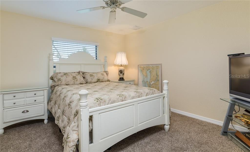 Guest bathroom with walk-in, enclosed shower - Single Family Home for sale at 515 Royal Poinciana Cir, Punta Gorda, FL 33955 - MLS Number is C7244338