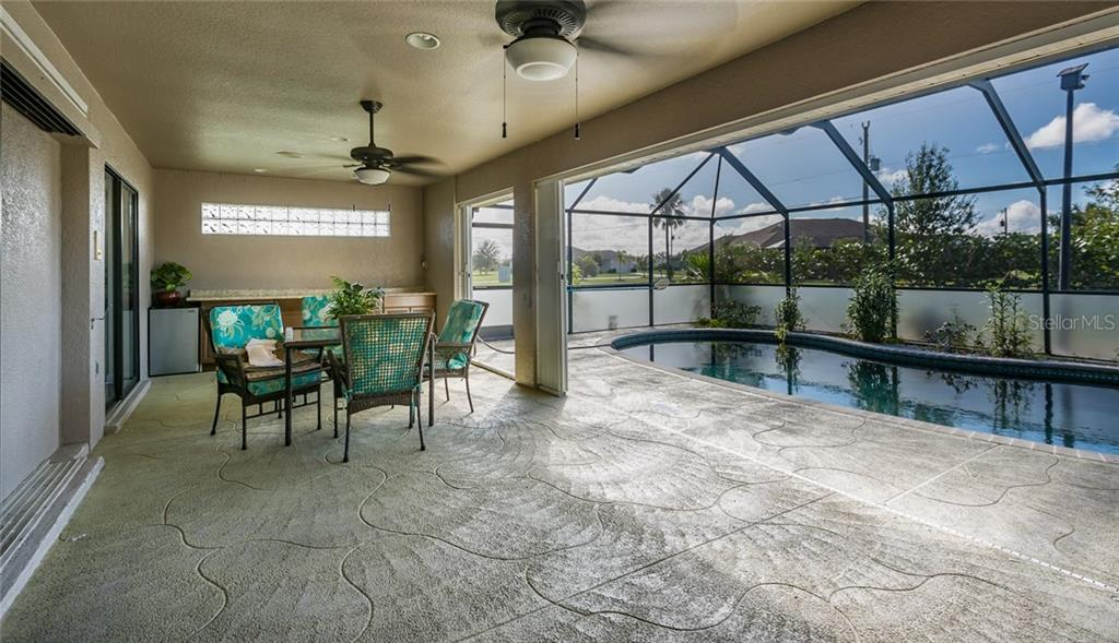 Master Bedroom with view of Lanai and Pool - Single Family Home for sale at 515 Royal Poinciana Cir, Punta Gorda, FL 33955 - MLS Number is C7244338