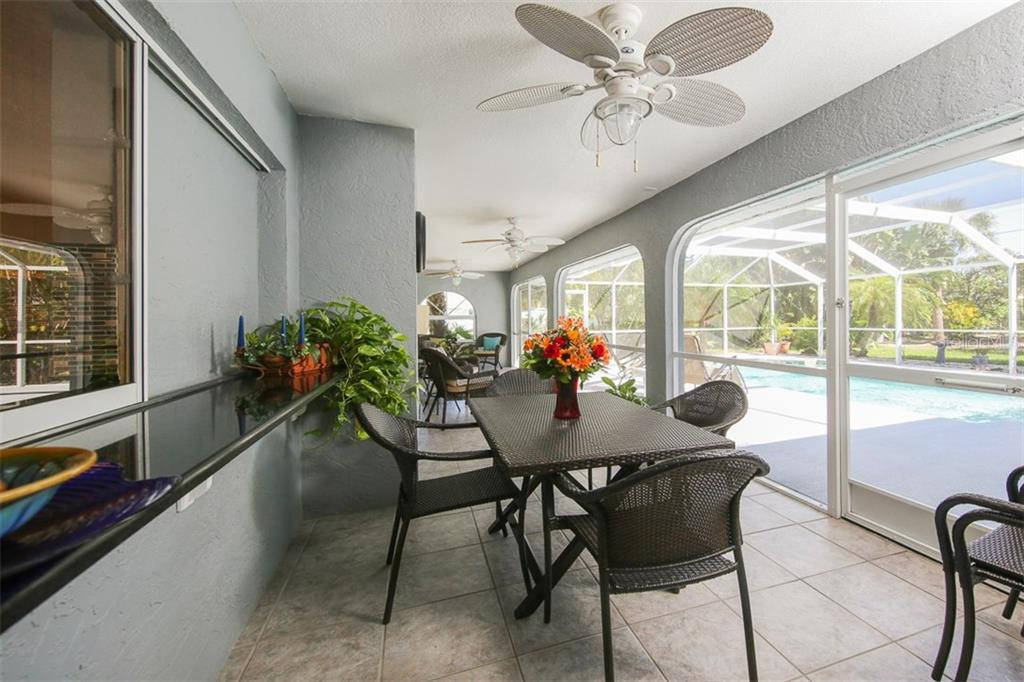 Fabulous large covered lanai - enjoy your morning coffee or evening libation - Single Family Home for sale at 4407 Albacore Cir, Port Charlotte, FL 33948 - MLS Number is C7245070