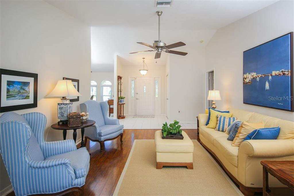 Inviting and gracious living room - Single Family Home for sale at 4407 Albacore Cir, Port Charlotte, FL 33948 - MLS Number is C7245070