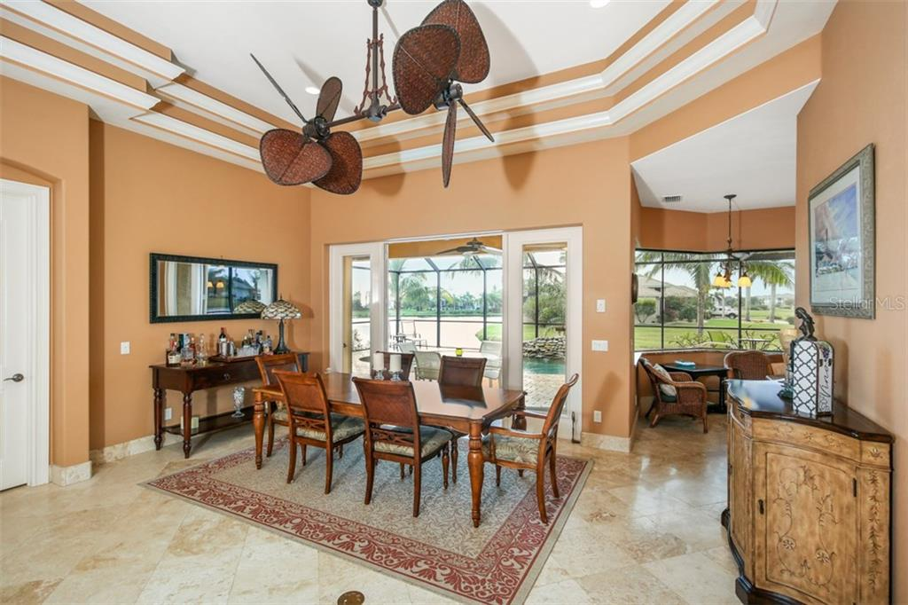 Diamond set travertine flooring and base boards, French doors, illuminated double tray ceiling and island style ceiling fan are just some of the fine features this home boasts! - Single Family Home for sale at 17208 Barcrest Ln, Punta Gorda, FL 33955 - MLS Number is C7245458