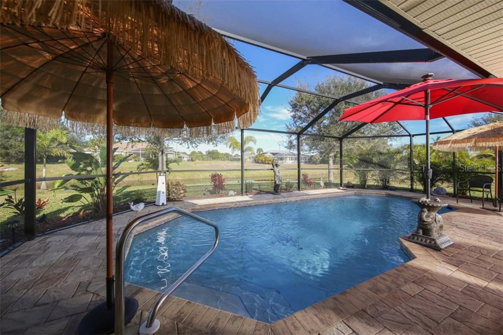 Heated saltwater pool with brick pavers was added in 2016 - Single Family Home for sale at 220 Broadmoor Ln, Rotonda West, FL 33947 - MLS Number is C7248036