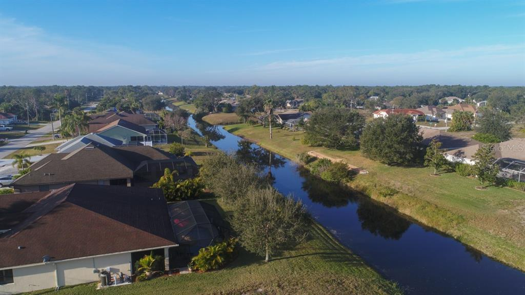 Overlooking this freshwater canal in the Broadmoor section of Rotonda West - your home awaits! - Single Family Home for sale at 220 Broadmoor Ln, Rotonda West, FL 33947 - MLS Number is C7248036
