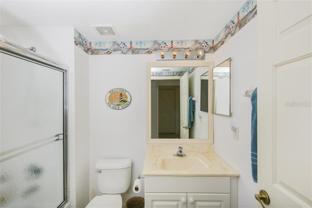 2nd Bath is convenient to the guest bedroom, laundry and garage. - Condo for sale at 3392 Sunset Key Cir #b, Punta Gorda, FL 33955 - MLS Number is C7249092