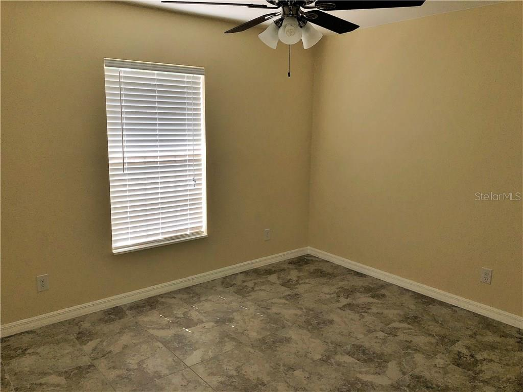 Master bathroom walk-in shower with beautiful tile from floor to ceiling. - Single Family Home for sale at 191 Broadmoor Ln, Rotonda West, FL 33947 - MLS Number is C7250730