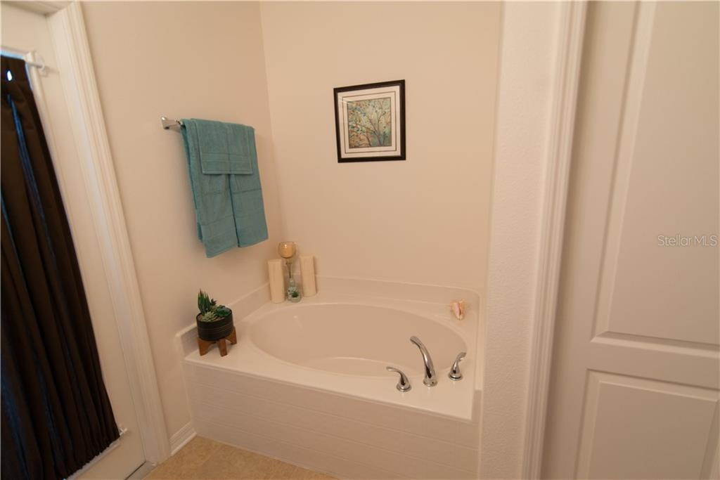 Find your Zen in a luxurious bubble bath.  Double-sink vanity and a door leading to screened patio. - Single Family Home for sale at 3773 Cobblestone Ln, Port Charlotte, FL 33980 - MLS Number is C7251290