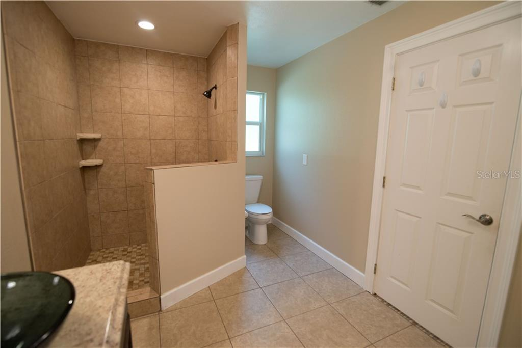 Contemporary and modern, you'll love your master bath with walk-in shower.  Lots of room for all your bathroom items in the spacious and convenient linen closet right inside your bathroom. - Single Family Home for sale at 3184 Ulman Ave, North Port, FL 34286 - MLS Number is C7400587