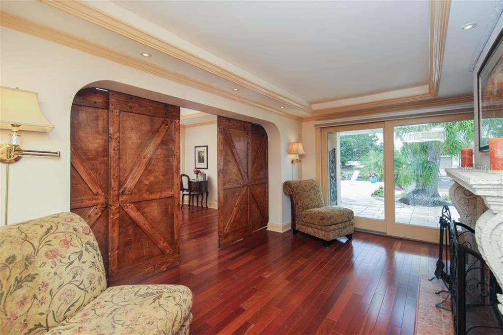 Wood flooring and newly installed custom barn doors that are truly gorgeous - Single Family Home for sale at 158 Morgan Ln Se, Port Charlotte, FL 33952 - MLS Number is C7400633