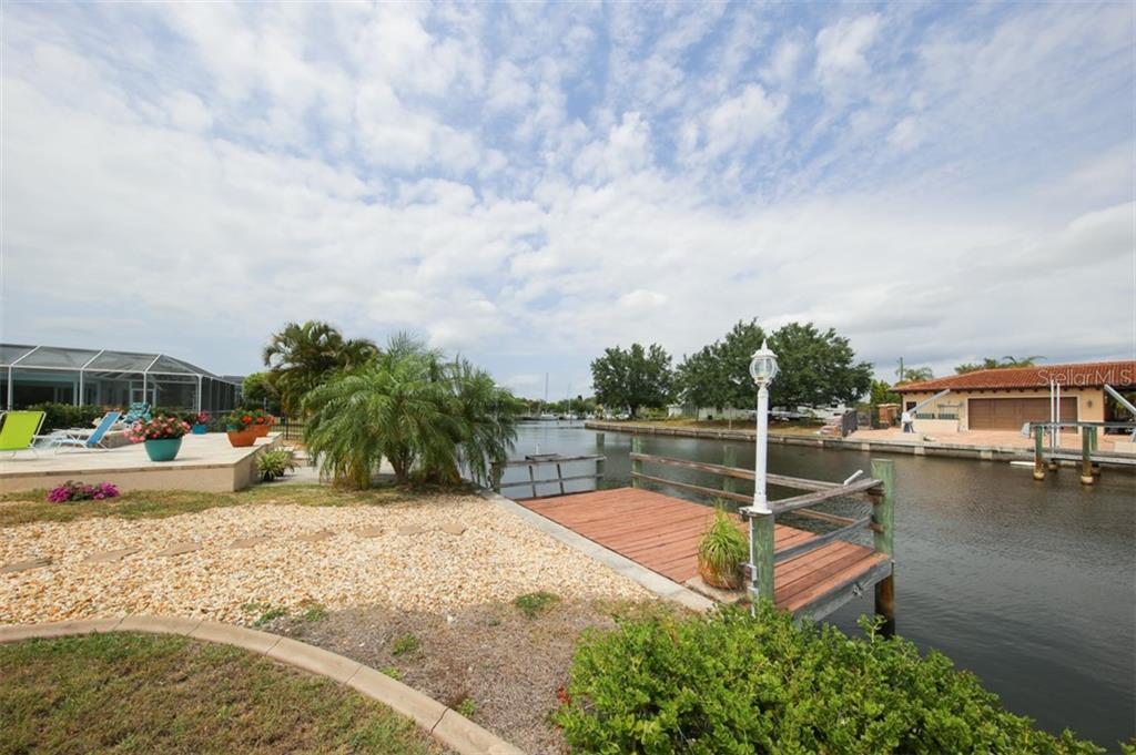 Wooden dock - Single Family Home for sale at 158 Morgan Ln Se, Port Charlotte, FL 33952 - MLS Number is C7400633