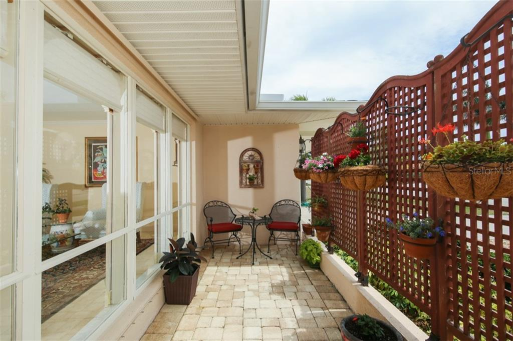 Lovely front patio creates beauty and privacy - Single Family Home for sale at 158 Morgan Ln Se, Port Charlotte, FL 33952 - MLS Number is C7400633