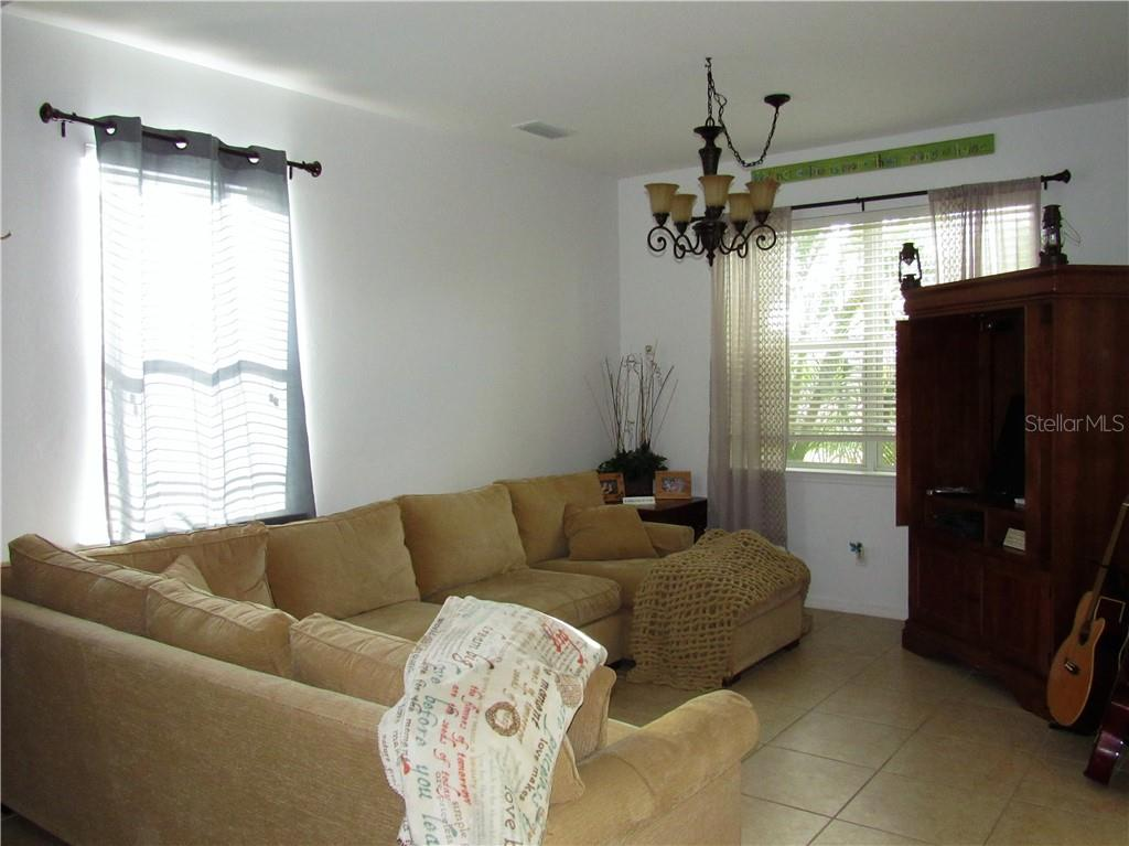 bright and airy living room - Single Family Home for sale at 24041 Canal St, Port Charlotte, FL 33980 - MLS Number is C7400879
