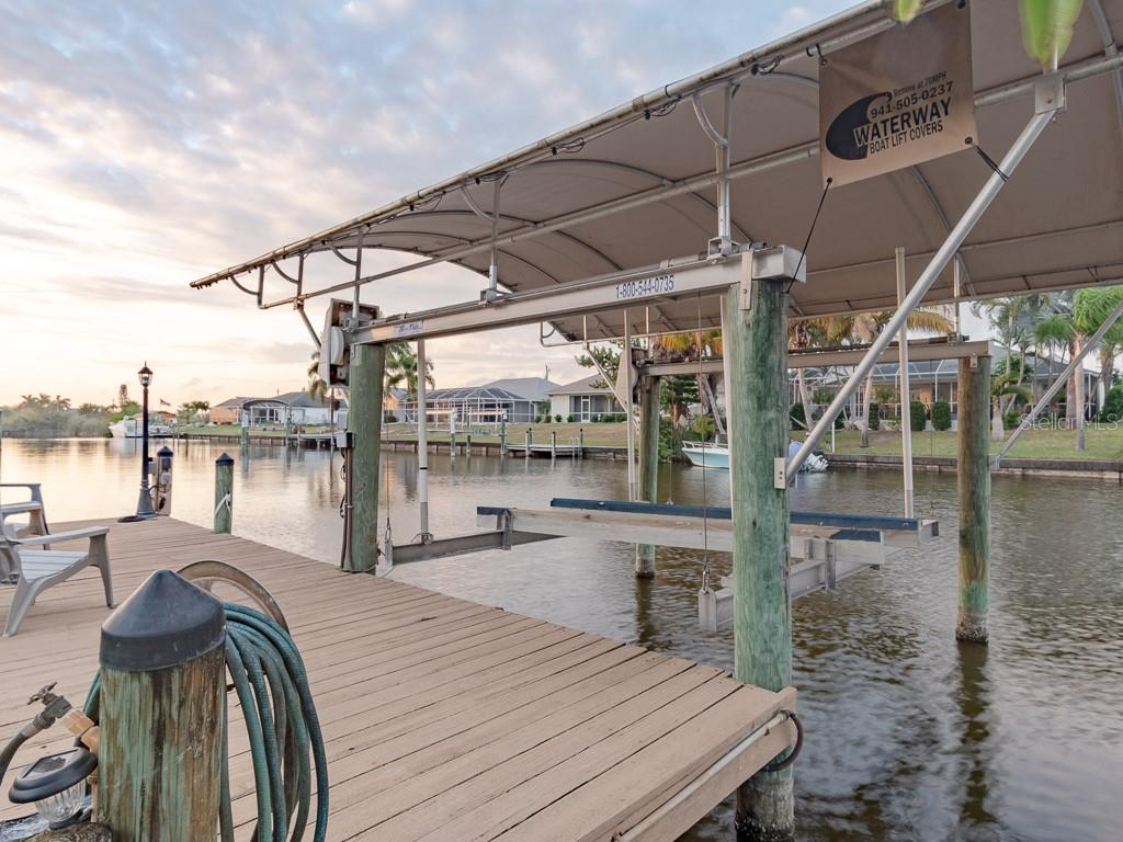 Your covered boat lift and dock with plenty of room for simply enjoying the sunsets - there's even a post light and a fish light! - Single Family Home for sale at 15464 Avery Rd, Port Charlotte, FL 33981 - MLS Number is C7401914