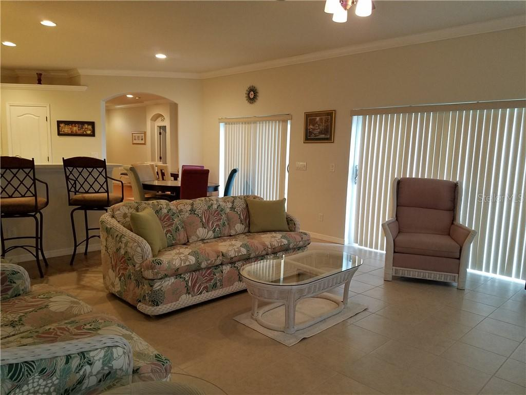 Multiple sliding glass doors provide open access to the pool and paver deck. - Single Family Home for sale at 2752 Suncoast Lakes Blvd, Punta Gorda, FL 33980 - MLS Number is C7402671