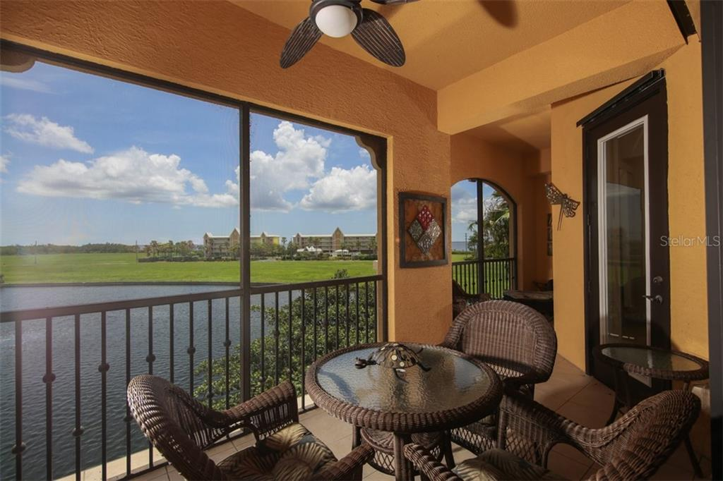 Lanai overlooks the large lake - Condo for sale at 95 Vivante Blvd #303, Punta Gorda, FL 33950 - MLS Number is C7402746