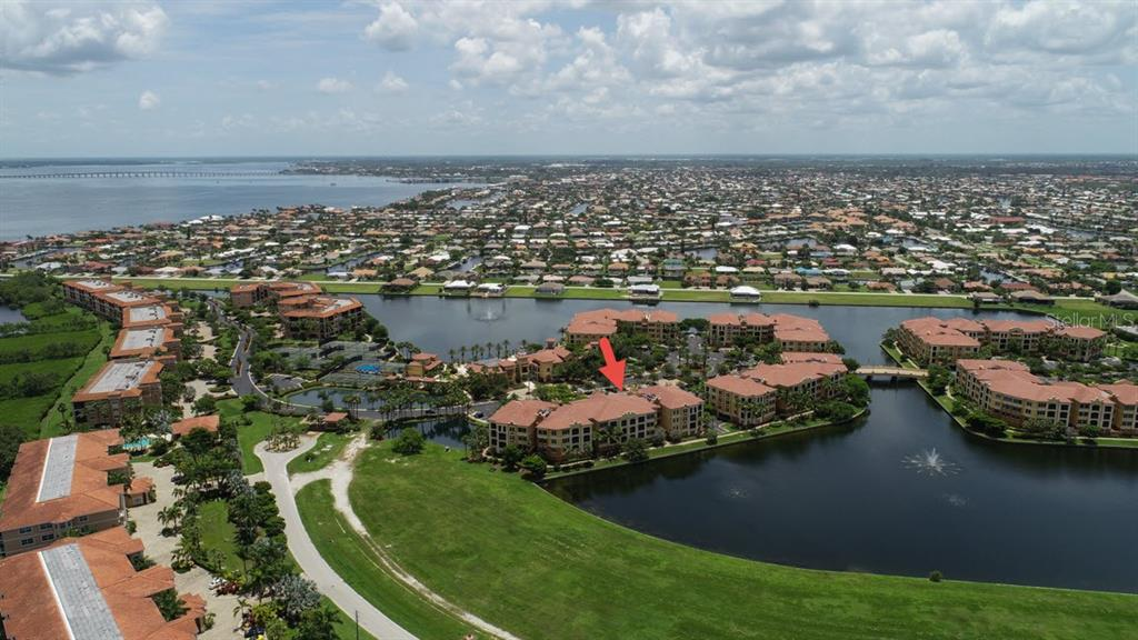 Building 95 on the beautiful lake with jetted fountains - Condo for sale at 95 Vivante Blvd #303, Punta Gorda, FL 33950 - MLS Number is C7402746
