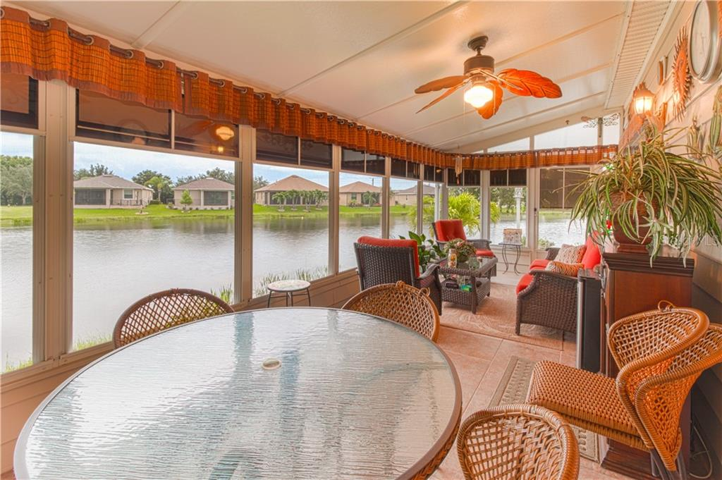 Lanai enclosed with tile floors and weatherproof windows. - Single Family Home for sale at 8663 Lake Front Ct, Punta Gorda, FL 33950 - MLS Number is C7403960