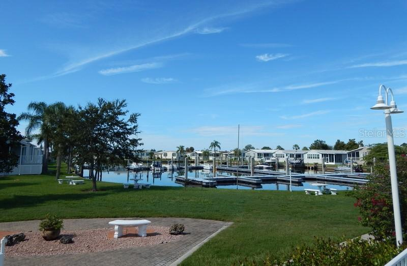 Marina with free boat slips - Manufactured Home for sale at 66 Windmill Blvd, Punta Gorda, FL 33950 - MLS Number is C7405183