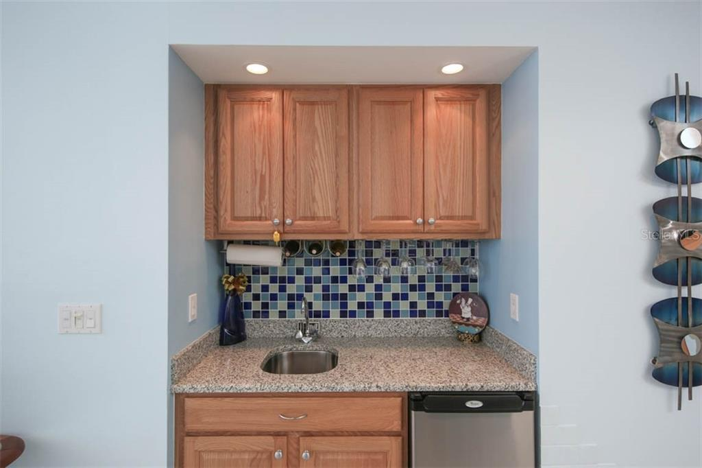 This handy wet bar is situated directly across from the dining area and is the perfect appointment that will keep folks out of the kitchen when entertaining family and friends. - Condo for sale at 3329 Sunset Key Cir #503, Punta Gorda, FL 33955 - MLS Number is C7406727