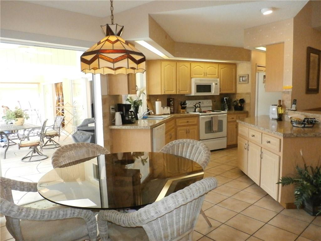 Kitchen view, eat-in area - Single Family Home for sale at 416 Bahia Grande Ave, Punta Gorda, FL 33983 - MLS Number is C7408301