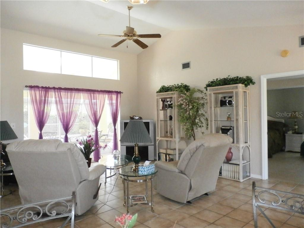 Living room with glass sliders to pool - Single Family Home for sale at 416 Bahia Grande Ave, Punta Gorda, FL 33983 - MLS Number is C7408301