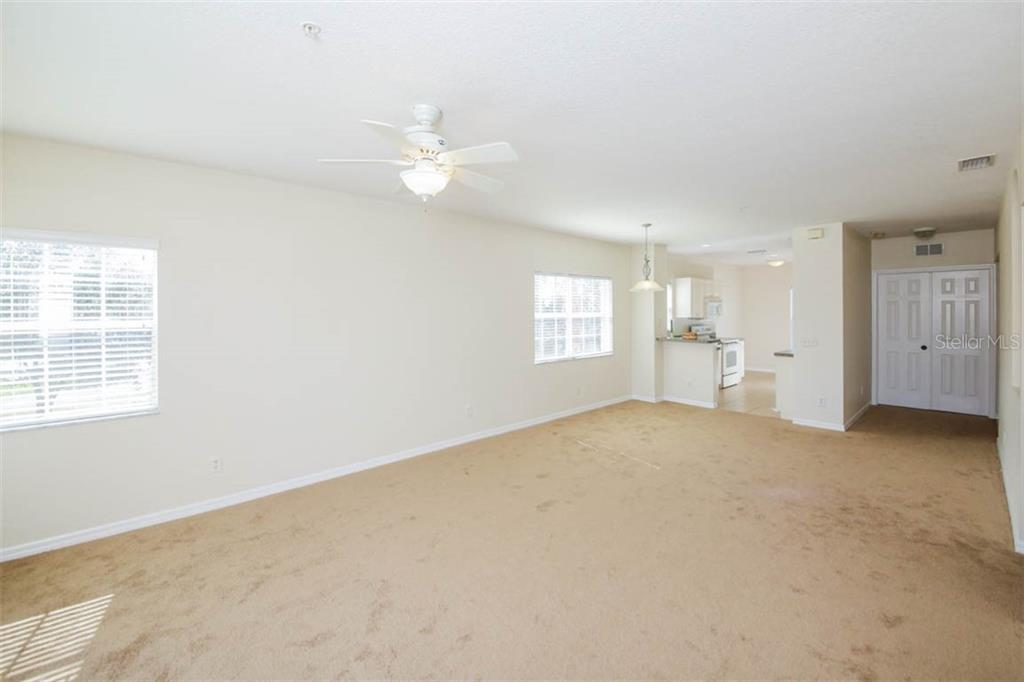 Empty Great Room with south facing end windows for lots of light. Double doors lead to BR 3 (or Den) - Condo for sale at 2040 Willow Hammock Cir #b208, Punta Gorda, FL 33983 - MLS Number is C7408424