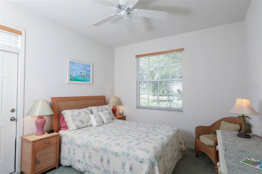 At the front of the villa is this 2nd bedroom with double closet and window offering views of the pond across the street.  There is a doorway that closes off this bedroom and bath from the main living area which is pretty handy for overnight guests affording privacy for all! - Villa for sale at 3181 Matecumbe Key Rd #6, Punta Gorda, FL 33955 - MLS Number is C7409111