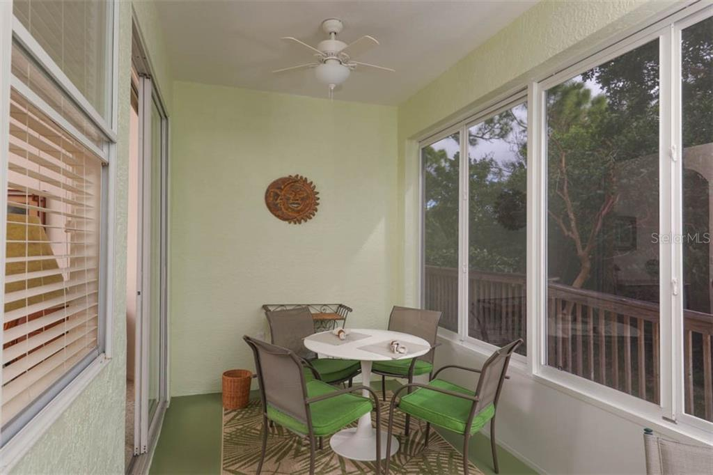 Delightful enclosed lanai features glass windows that will allow you to close on those rare chilly days, and slide open on fair days to usher in tropical breezes and salt air. - Villa for sale at 3181 Matecumbe Key Rd #6, Punta Gorda, FL 33955 - MLS Number is C7409111