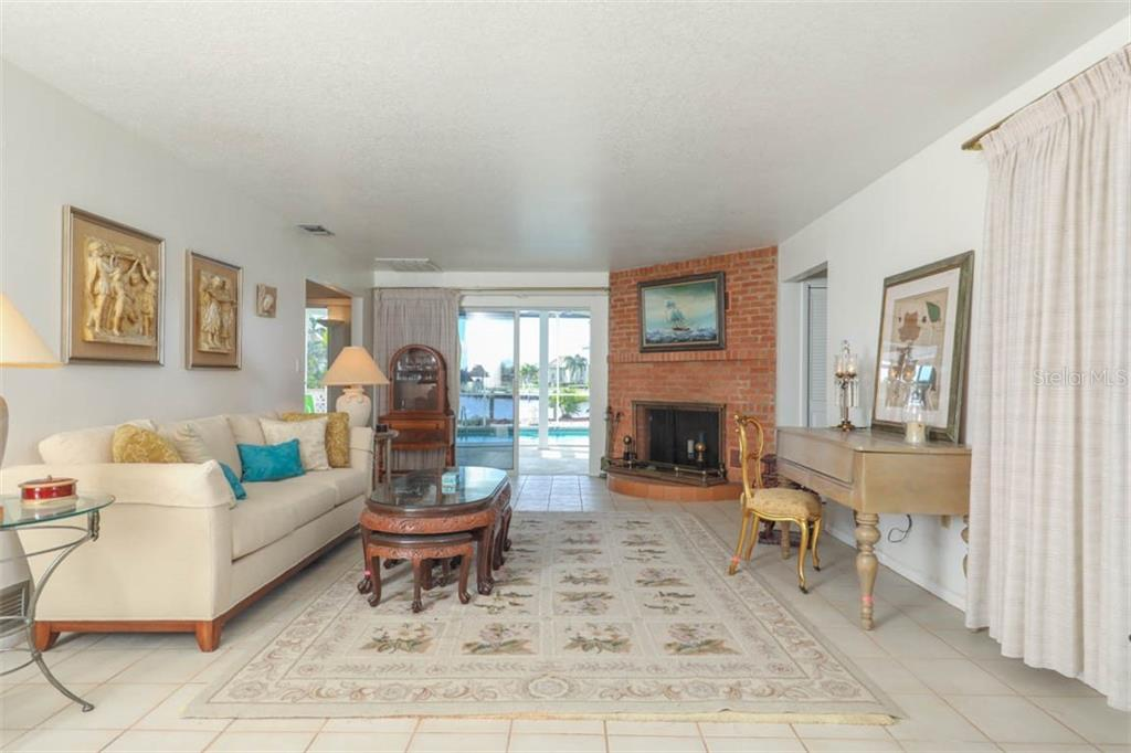 Living Room provides vista to pool & waterfront - Single Family Home for sale at 2291 Bayview Rd, Punta Gorda, FL 33950 - MLS Number is C7409445