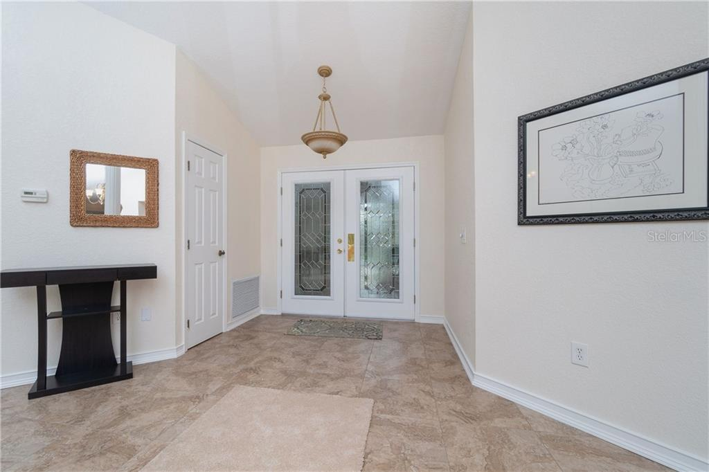 Double door entry with leaded glass. Coat closet - Single Family Home for sale at 572 Toulouse Dr, Punta Gorda, FL 33950 - MLS Number is C7411184