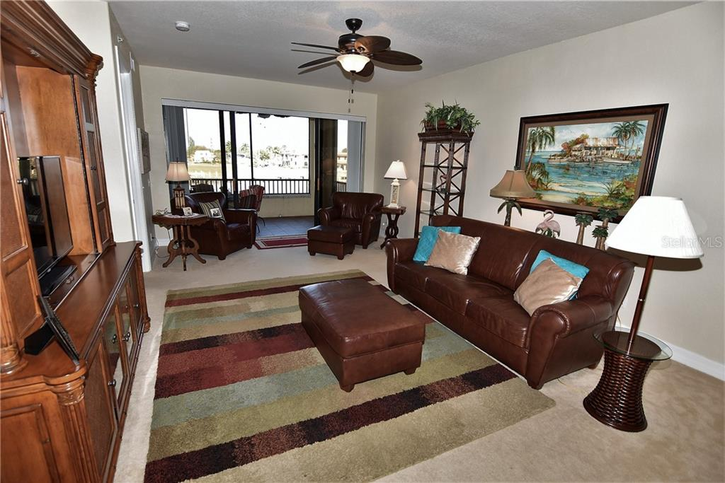 Great room with screened lanai in distance - Condo for sale at 1340 Rock Dove Ct #124, Punta Gorda, FL 33950 - MLS Number is C7411764