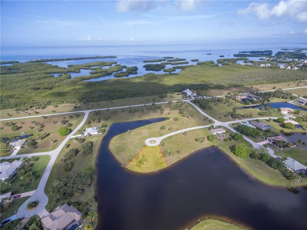 Charlotte Harbor just beyond this oversized waterfront lot - Vacant Land for sale at 16308 Cayman Ln, Punta Gorda, FL 33955 - MLS Number is C7413152