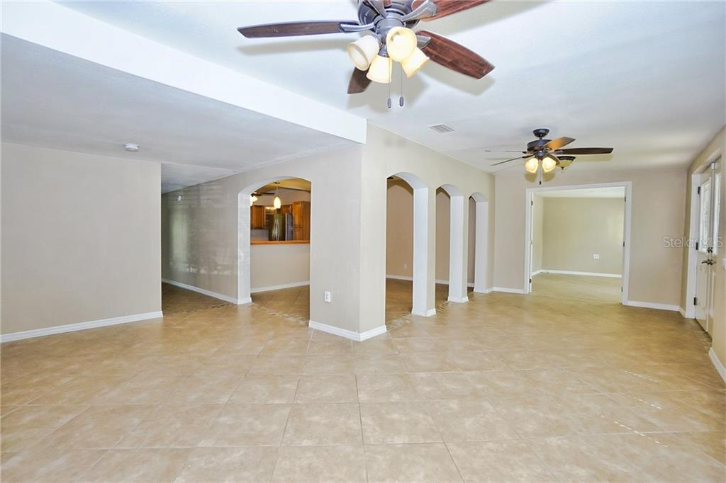 Full View of the Main Living Space - including Front Living Room, Office/Den, Kitchen & Dining Areas - Single Family Home for sale at 3513 Areca St, Punta Gorda, FL 33950 - MLS Number is C7414620